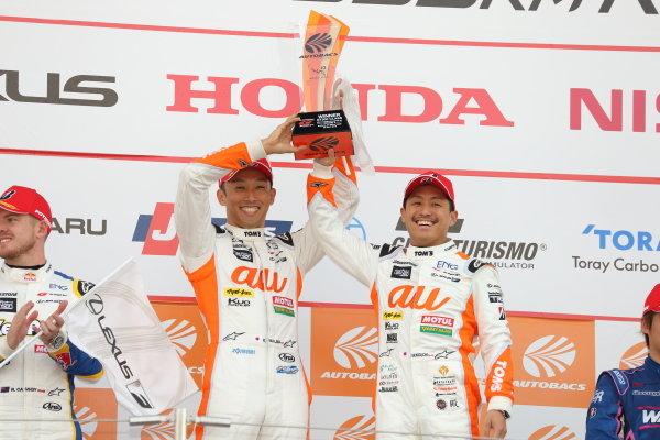 GT500 Winners Kazuki Nakajima & Yuhi Sekiguchi, Lexus Team au TOM'S LC500, raise their trophy on the podium