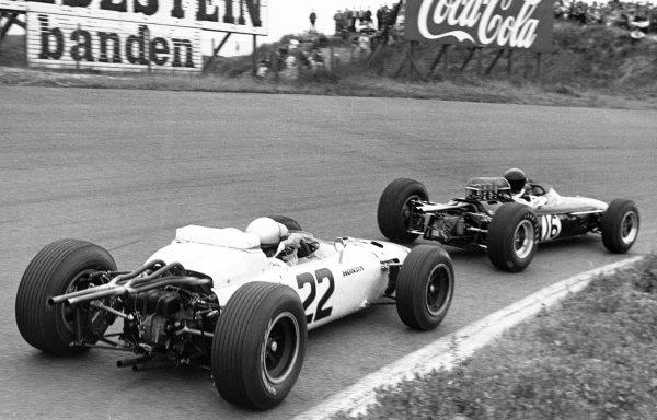 1965 Dutch Grand Prix.Zandvoort, Holland. 18 July 1965.Dan Gurney (Brabham BT11 Climax) 3rd position, leads Richie Ginther, Honda RA272, 6th position, action.World Copyright: LAT PhotographicRef: Motor b&w print