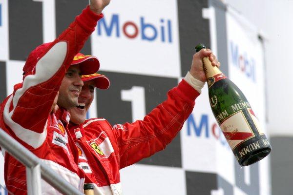 2006 German Grand Prix - Sunday Race Hockenheim, Germany. 27th - 30th July. Michael Schumacher, Ferrari 248F1, 1st position, celebrates his 89th win and 70th for Ferrari, with Felipe Massa, Ferrari 248F1, 2nd position, podium. World Copyright: Steven Tee/LAT Photographic ref: Digital Image VY9E3807