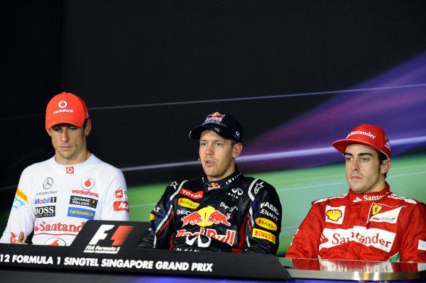 Press Conference (L to R): Jenson Button (GBR) McLaren, Sebastian Vettel (GER) Red Bull Racing and Fernando Alonso (ESP) Ferrari. Formula One World Championship, Rd14, Singapore Grand Prix, Race, Marina Bay Street Circuit, Singapore, Sunday 23 September 2012.