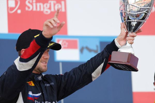2013 GP2 Series. Round 10.  Marina Bay Circuit, Singapore. 22nd September 2013. Sunday Race.  Sam Bird (GBR, RUSSIAN TIME) celebrates his victory on the podium.  World Copyright: Andrew Ferraro/GP2 Media Service  ref: Digital Image _79P8427.jpg