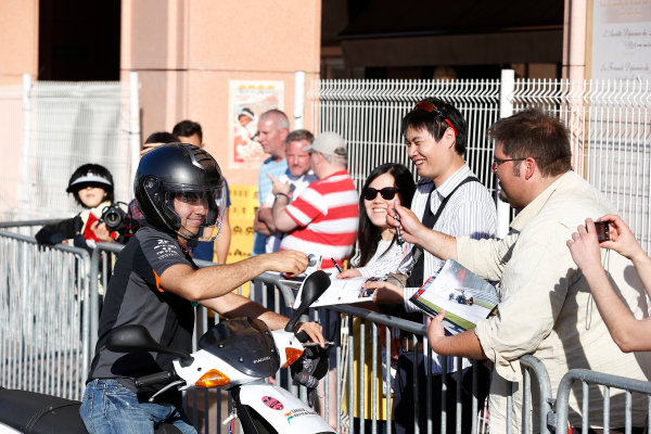 Monte Carlo, Monaco. Wednesday 20 May 2015. Sergio Perez, Force India, signs autographs for fans. World Copyright: Charles Coates/LAT Photographic. ref: Digital Image _N7T0865