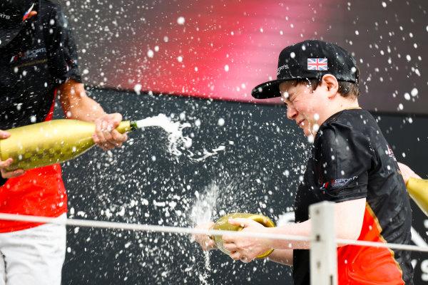 Yas Marina Circuit, Abu Dhabi, United Arab Emirates. Sunday 26 November 2017. E-Sports champion Brendon Leigh celebrates on the podium. World Copyright: Sam Bloxham/LAT Images  ref: Digital Image _W6I3840