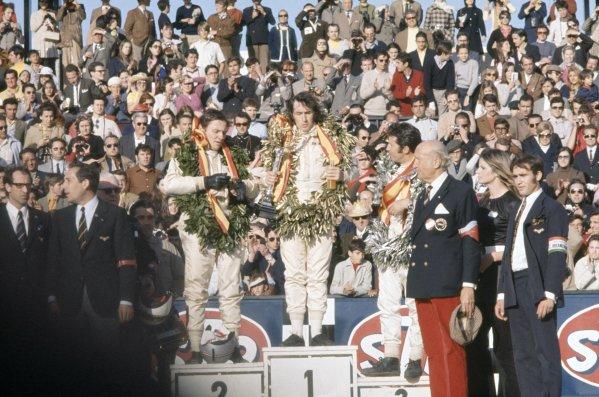Jarama, Spain. 17th - 19th April 1970.Jackie Stewart (March 701-Ford Cosworth), 1st position, Bruce McLaren (McLaren M14A-Ford Cosworth), 2nd position, and Mario Andretti (March 701-Ford Cosworth), 3rd position on the podium, portrait. World Copyright: LAT PhotographicRef: 70ESP07