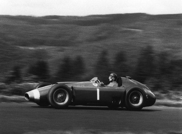 Nurburgring, Germany. 1956race winner Juan Manuel Fangio (Lancia ferrari D50), action.World Copyright: LAT Photographicref: 413/10