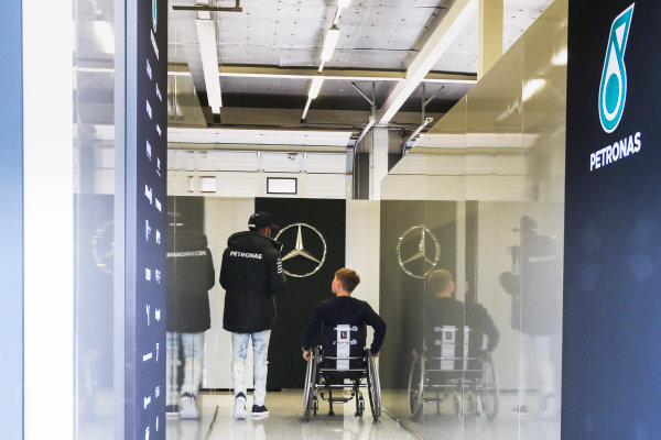 Silverstone, Northamptonshire, UK.  Friday 14 July 2017. Lewis Hamilton, Mercedes AMG, with Billy Monger. World Copyright: Charles Coates/LAT Images  ref: Digital Image AN7T7478