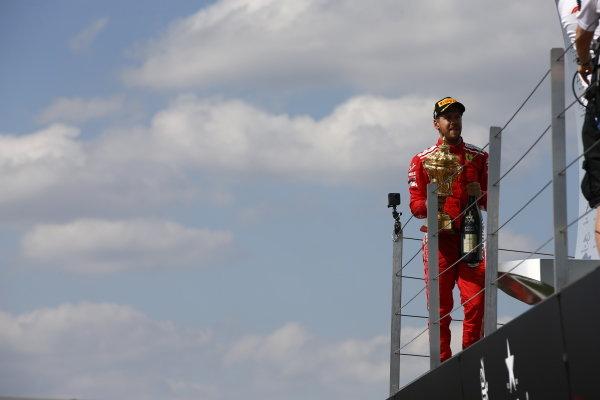 Sebastian Vettel, Ferrari, with his trophy after winning the race.