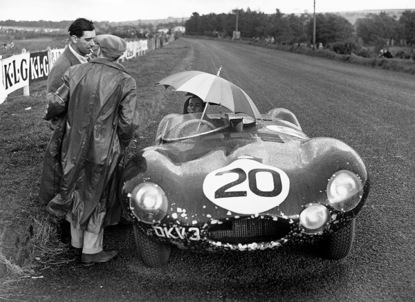 Dundrod, Northern Ireland. 11 September 1954.Stirling Moss / Peter Walker (Jaguar D-Type), 18th position,waiting in the rain,  portraitWorld Copyright: LAT Photographic.Ref: Autocar Glass Plate C40658