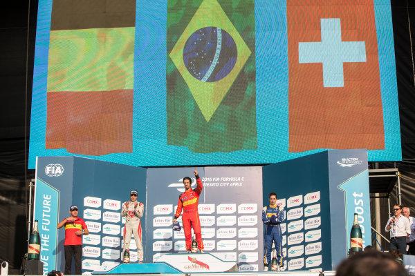 Mexico City e-Prix, Mexico, Central America. Sunday 13 March 2016 Lucas Di Grassi (BRA), ABT Audi Sport FE01, Jerome D'Ambrosio (FRA) Dragon Racing - Venturi VM200-FE-01, Sebastien Buemi (SUI), Renault e.Dams Z.E.15 podium. Photo: Andrew Ferraro/LAT/FE ref: Digital Image _FER6559