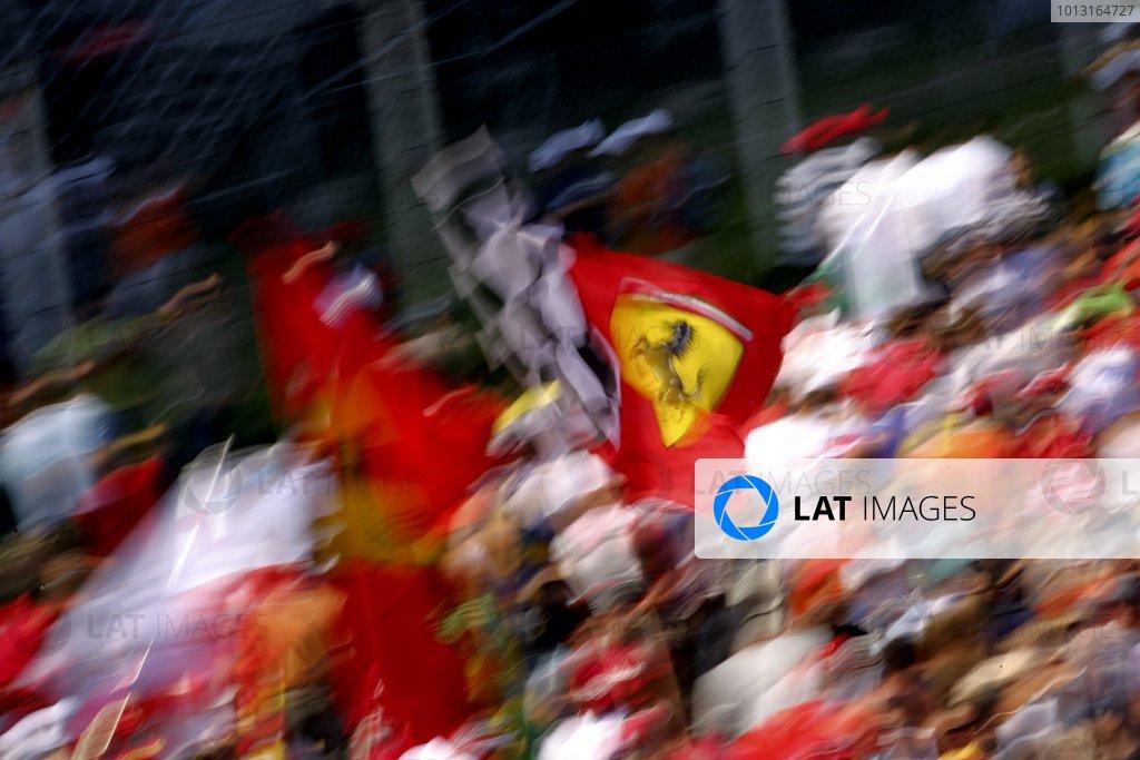 2007 Italian Grand PrixAutodromo di Monza, Monza, Italy.7th - 9th September 2007.Tifosi fans wave Ferrari flags from the crowd. Atmosphere.World Copyright: Lorenzo Bellanca/LAT Photographicref: Digital Image ZD2J8779