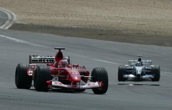 2003 European Grand Prix - Sunday Race, Nurburgring, Germany. 29th June 2003 Rubens Barrichello, Ferrari F2003 GA, leads Juan-Pablo Montoya, BMW Williams FW25, action.World Copyright: Steve Etherington/LAT Photographic ref: Digital Image Only