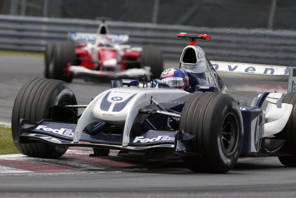 2004 Canadian Grand Prix - Sunday Race,Montreal, Canada. 13th June 2004. Juan Pablo Montoya, BMW Williams FW26, leads Olivier Panis, Toyota TF104, into the hairpin - both would later be disqualified for running illegal brake ducts. Action.World Copyright: Steve Etherington/LAT Photographic ref: Digital Image Only