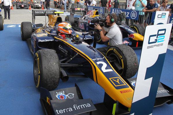 Race one winner Alex Lynn (GBR) DAMS celebrates in parc ferme at GP2 Series, Rd6, Hungaroring, Hungary, 24-26 July 2015.