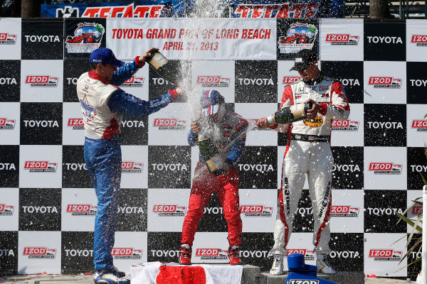 19-21 April, 2013, Long Beach, California, USA Justin Wilson, Takuma Sato and Graham Rahal on the podium with champagne © 2013, Michael L. Levitt LAT Photo USA