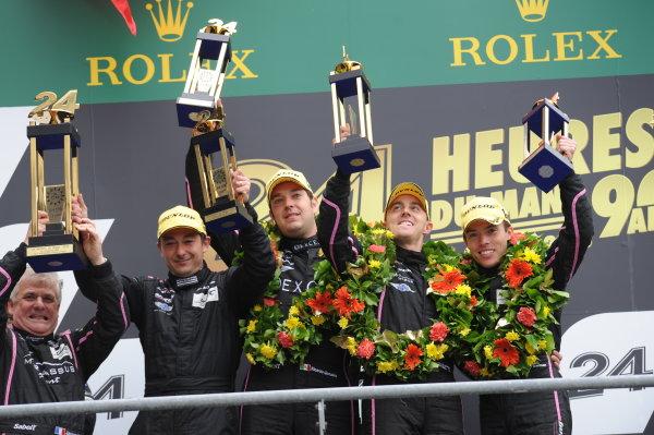 Circuit de La Sarthe, Le Mans, France. 21st-23rd June 2013. Bertrand Baguette/Ricardo Gonzalez/Martin Plowman, OAK Racing, No 35 Morgan-Nissan LMP2 celebrate LMP2 Class win. Podium. World Copyright: Jeff Bloxham/LAT Photographic ref: Digital Image DSC_9763