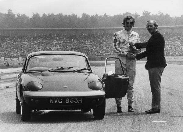 Hockenheim, Germany. 31st July - 2nd August 1970. Colin Chapman presents Jochen Rindt with the keys to a new Lotus Elan on the grid at Hockenheim, portrait. World Copyright: LAT Photographic. Ref: B/W Print.