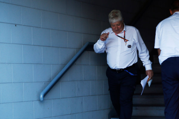 Autodromo Nazionale di Monza, Monza, Italy. Sunday 6 September 2015. Herbie Blash, Deputy Race Director, FIA, leaves an FIA stewards enquiry concerning Mercedes' tyre pressures. World Copyright: Jed Leicester/LAT Photographic ref: Digital Image _L2_9446