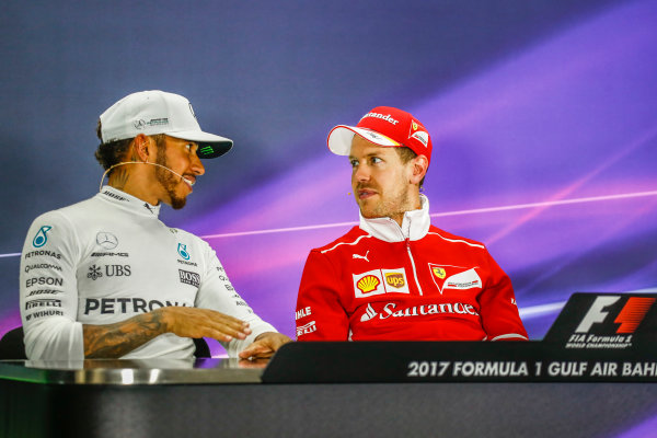 Bahrain International Circuit, Sakhir, Bahrain.  Sunday 16 April 2017. All smiles between Lewis Hamilton, Mercedes AMG, 2nd Position, and Sebastian Vettel, Ferrari, 1st Position, in the Press Conference. World Copyright: Sam Bloxham/LAT Images ref: Digital Image _W6I3410
