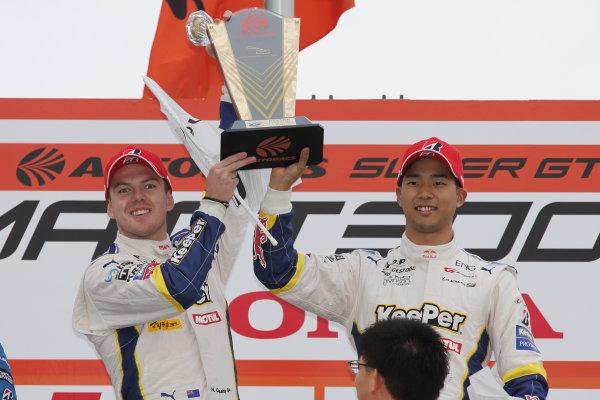 2017 Japanese Super GT Series. Okayama, Japan. 8th - 9th April 2017. Rd 1. GT500 Winner Ryo Hirakawa & Nick Cassidy ( #37 KeePer TOM'S LC500 ) podium, portrait World Copyright: Yasushi Ishihara / LAT Images. Ref: 2017SGT_Rd1_005