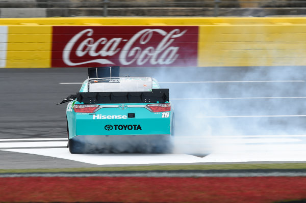 26-28 May, 2016, Concord, North Carolina USA Denny Hamlin, Hisense USA Toyota Camry (18), celebrates by doing a burnout after winning the Hisense 300. ©2016, John Harrelson / LAT Photo USA