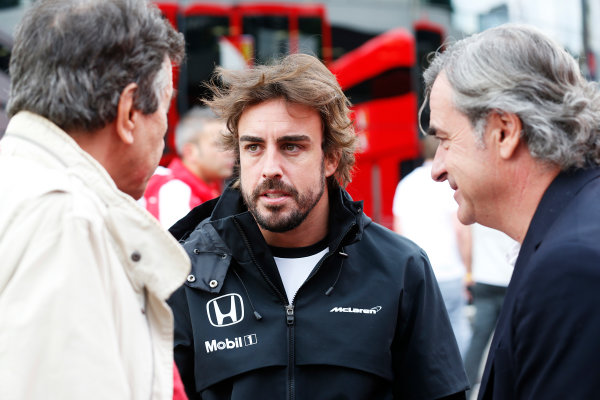 Red Bull Ring, Spielberg, Austria. Thursday 18 June 2015. Fernando Alonso, McLaren, talks to Carlos Sainz. World Copyright: Alastair Staley/LAT Photographic. ref: Digital Image _R6T6859