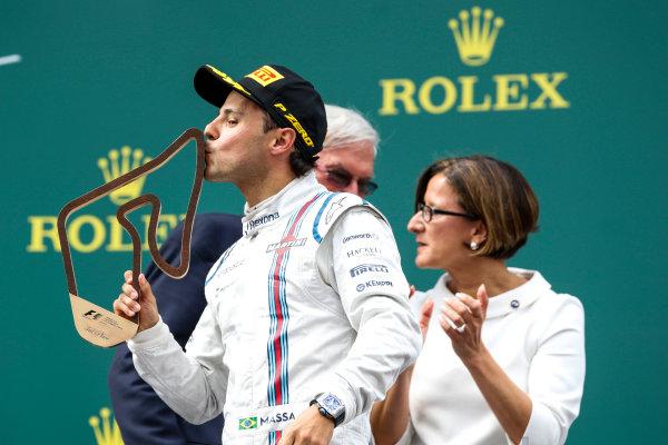 Red Bull Ring, Spielberg, Austria. Sunday 21 June 2015. Felipe Massa, Williams F1, 3rd Position, kisses his trophy. World Copyright: Glenn Dunbar/LAT Photographic. ref: Digital Image _89P5751