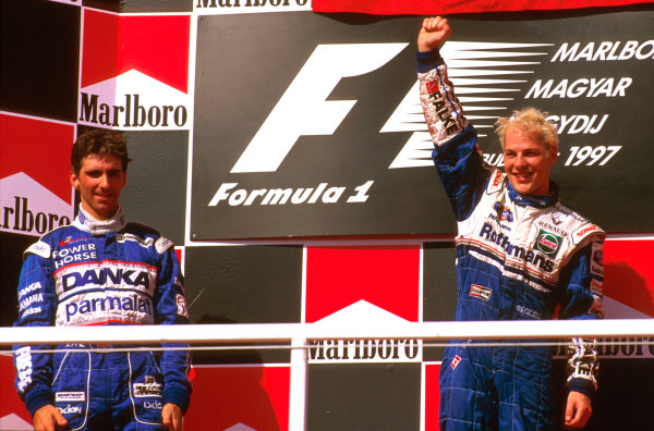 Hungaroring, Hungary.8-10 August 1997.Jacques Villeneuve (Williams Renault) 1st position and Damon Hill (Arrows Yamaha) 2nd position celebrate on the podium.Ref-97 HUN 21.World  Copyright - LAT Photographic