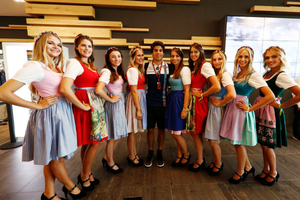 Red Bull Ring, Spielberg, Austria. Saturday 08 July 2017. Lance Stroll, Williams Martini Racing, poses with a girls wearing traditional Austrian dress. World Copyright: Glenn Dunbar/LAT Images ref: Digital Image _31I5660