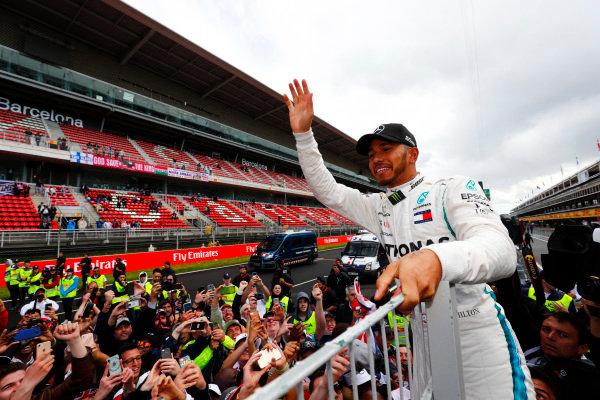 Lewis Hamilton, Mercedes AMG F1, 1st position, celebrates with fans.