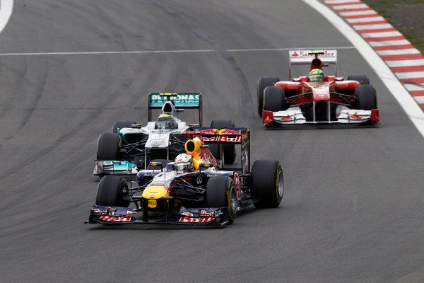 Nurburgring, Germany24th July 2011Sebastian Vettel, Red Bull Racing RB7 Renault, 4th position, leads Nico Rosberg, Mercedes GP W02, 7th position, and Felipe Massa, Ferrari 150° Italia, 5th position. Action. World Copyright: Andrew Ferraro/LAT Photographicref: Digital Image _Q0C9905