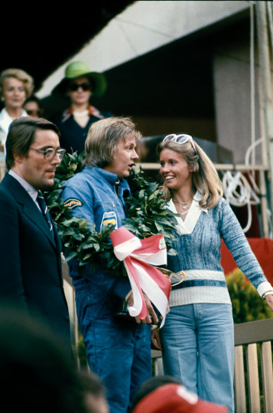 Monte Carlo, Monaco. 23-26 May 1974. Ronnie Peterson (Lotus 72E-Ford), 1st position, on the podium with his wife Barbro, portrait.  World Copyright: LAT Photographic. Ref: 74MON41