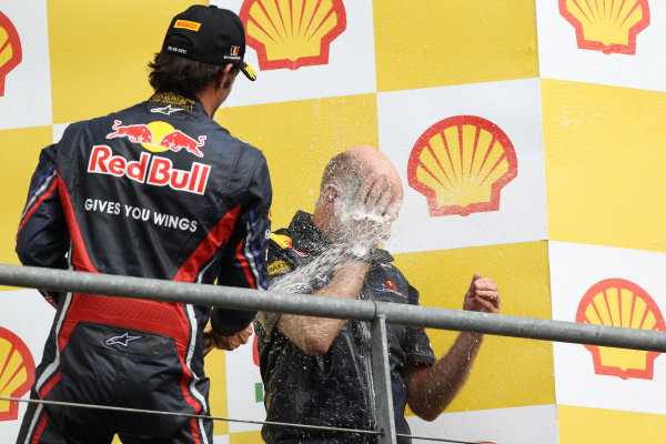 Spa-Francorchamps, Spa, Belgium28th August 2011.Mark Webber, Red Bull Racing RB7 Renault, 2nd position, soaks Adrian Newey, Chief Technical Officer, Red Bull Racing. Portrait. Podium. World Copyright: Andy Hone/LAT Photographicref: Digital Image CI0C2530