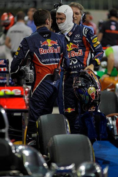 Yas Marina Circuit, Abu Dhabi, United Arab Emirates12th November 2011.Sebastian Vettel, Red Bull Racing RB7 Renault, celebrates pole in Parc Ferme. Portrait. Helmets. World Copyright:Glenn Dunbar/LAT Photographic ref: Digital Image _G7C4531