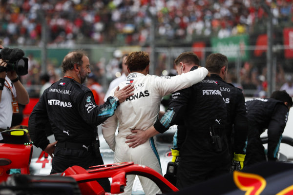 Lewis Hamilton, Mercedes AMG F1, celebrates with team mates after securing his 5th world drivers championship title