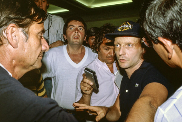 Niki Lauda speaks to the press regarding the drivers' strike in protest at the new superlicence conditions imposed by FISA.