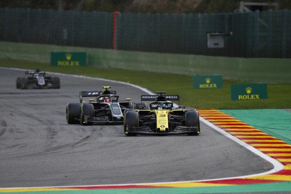 Daniel Ricciardo, Renault R.S.19, leads Kevin Magnussen, Haas VF-19, and Romain Grosjean, Haas VF-19