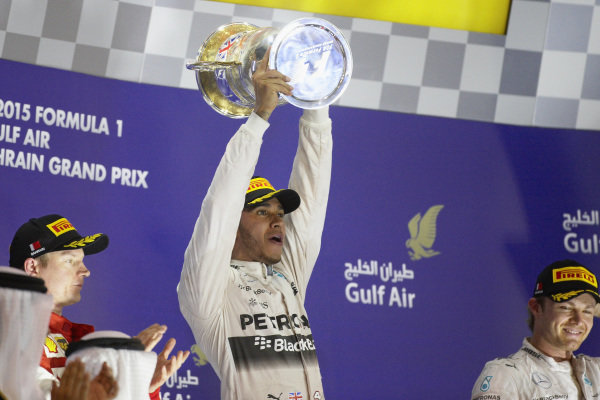 Lewis Hamilton, 1st position, celebrates with the trophy, Kimi Räikkönen, Ferrari and Nico Rosberg, 3rd position.