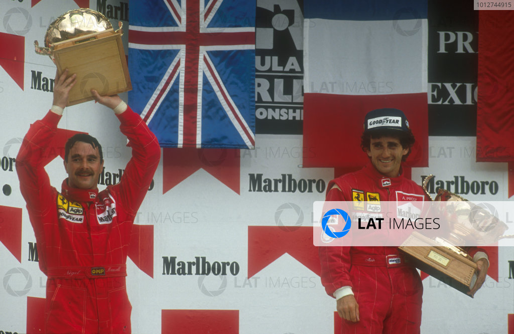 1990 Mexican Grand Prix.Mexico City, Mexico.8-10 June 1990.Alain Prost, 1st position and teammate Nigel Mansell, 2nd position (both Ferrari) on the podium. Ref-90 MEX 01.World Copyright - LAT Photographic
