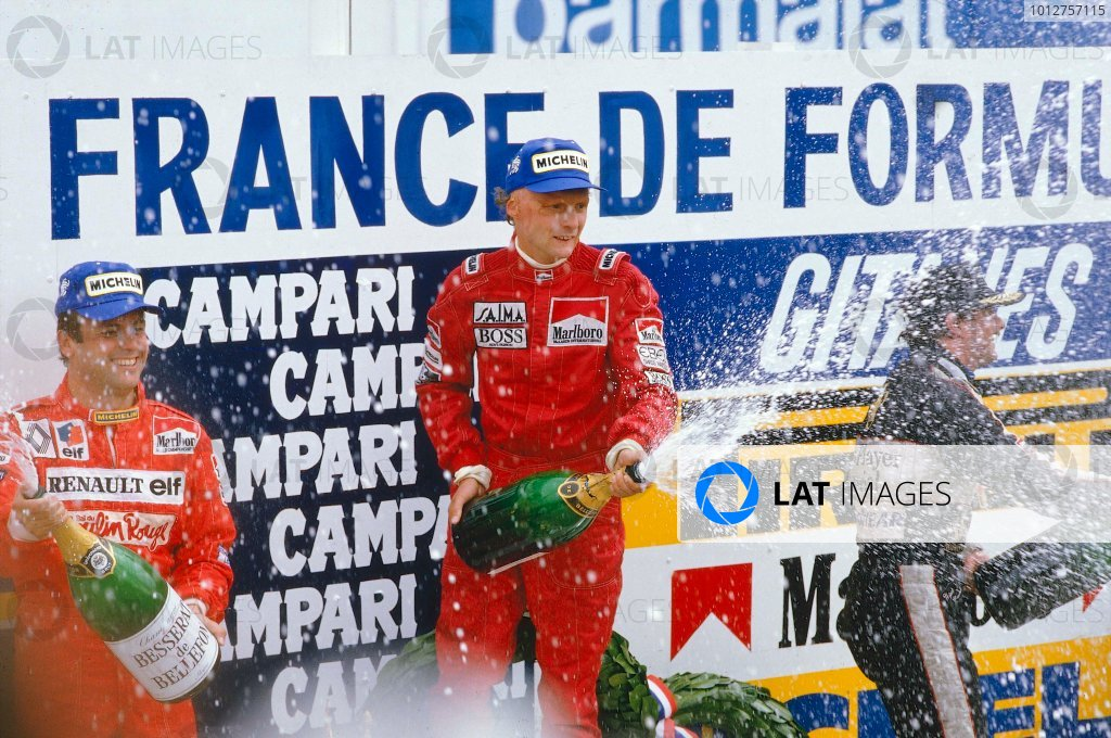 1984 French Grand Prix.Dijon-Prenois, France.18-20 May 1984.Niki Lauda (McLaren TAG Porsche) 1st position, Patrick Tambay (Renault) 2nd position and Nigel Mansell (Lotus Renault) 3rd position on the podium.Ref-84 FRA 01.World Copyright - LAT Photographic