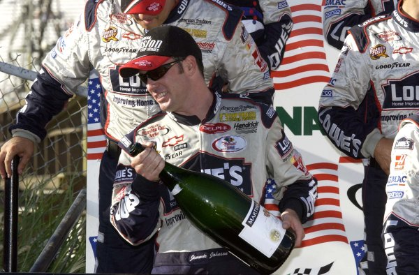 2002 NASCAR,Dover Downs,Sept 20-22, 20022002 NASCAR, Dover,Del . USA -Jimme Johnson gets ready to douse the people on hand with his winning champagne,Copyright-Robt LeSieur2002LAT Photographic