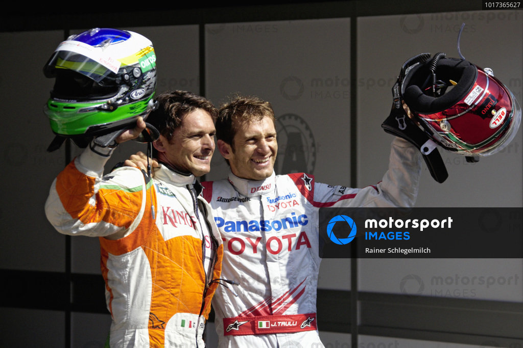 A surprise front row: pole sitter Giancarlo Fisichella with fellow Italian Jarno Trulli in parc ferme.