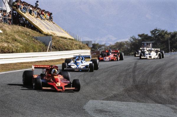 Gunnar Nilsson, Lotus 78 Ford leads Jacques Laffite, Ligier JS7 Matra and Hans-Joachim Stuck, Brabham BT45B Alfa Romeo.