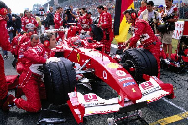 Final checks are made on Michael Schumacher's Ferrari F2004 before the race.