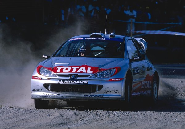 2002 World Rally ChampionshipNeste Rally of Finland. 8th - 11th August 2002.Rally winner Marcus Gronholm/Timo Rautianen, Peugeot 206 WRC, action.World Copyright: McKlein/LAT Photographicref: 35mm Image A03