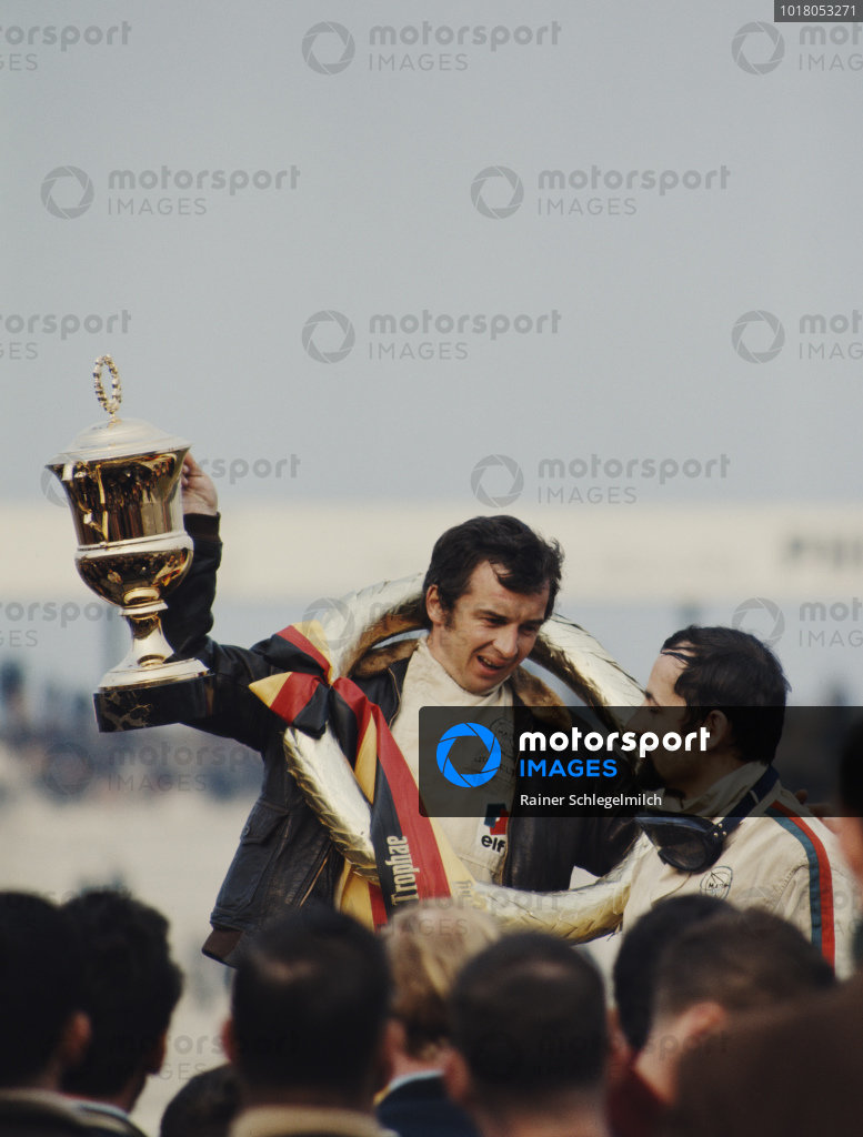 Jean-Pierre Beltoise celebrates victory on the podium with second placed teammate Henri Pescarolo.