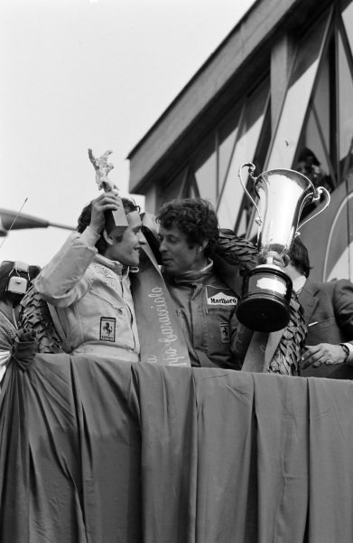 Winners Jacky Ickx and Brian Redman celebrate on the podium.