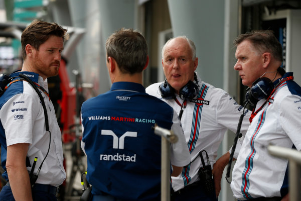 Sepang International Circuit, Sepang, Kuala Lumpur, Malaysia. Saturday 28 March 2015. Rob Smedley, Head of Vehicle Performance, Williams F1, Mike O' Driscoll, Group CEO, Williams F1, and Williams colleagues in discussion. World Copyright: Glenn Dunbar/LAT Photographic. ref: Digital Image _89P0005