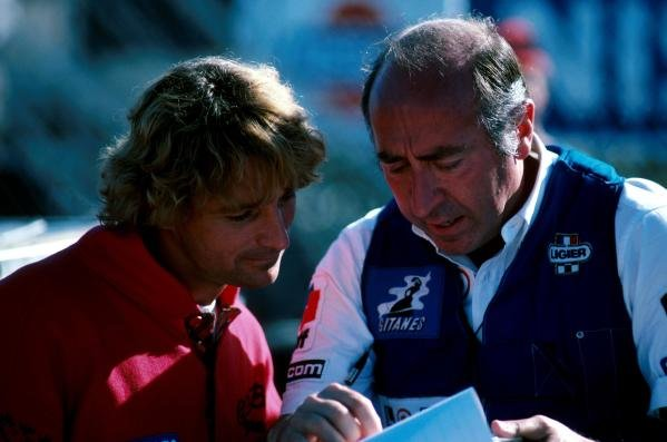 Rene Arnoux (FRA) (l) and Ligier engineer