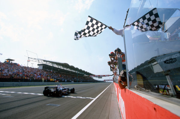 2005 Hungarian Grand Prix. Hungaroring, Hungary. 29th - 31st July 2005 Kimi Raikkonen, McLaren Mercedes MP4-20 crosses the line to take victory. Action. World Copyright: Michael Cooper/LAT Photographic Ref: 35mm Image A20