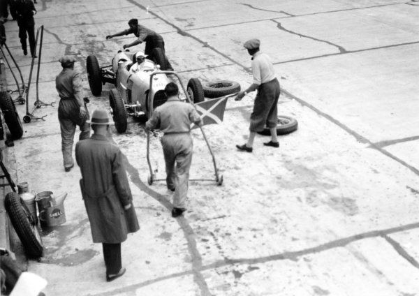 1934 German Grand Prix Nurburgring, Germany. 15 July 1934 Hans Stuck, Auto Union A, 1st position, pitstop. Team Manager Willy Walb supervises on the right, action World Copyright: Robert Fellowes/LAT PhotographicRef: 34GER01